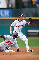 Rochester Red Wings second baseman James Beresford (2) shows the ball after attempting to tag Quintin Berry (17) stealing second during a game against the Pawtucket Red Sox on July 1, 2015 at Frontier Field in Rochester, New York.  Rochester defeated Pawtucket 8-4.  (Mike Janes/Four Seam Images)