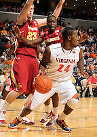 Dec. 30, 2010; Charlottesville, VA, USA; Virginia Cavaliers guard K.T. Harrell (24) is defended by Iowa State Cyclones forward Jamie Vanderbeken (23) and Iowa State Cyclones forward Melvin Ejim (3) during the game at the John Paul Jones Arena. Iowa State Cyclones won 60-47. Mandatory Credit: Andrew Shurtleff