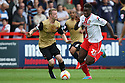 Oumare Tounkara of Stevenage escapes from Nathan Clarke of Leyton Orient<br />  - Stevenage v Leyton Orient - Sky Bet League 1 - Lamex Stadium, Stevenage - 17th August, 2013<br />  © Kevin Coleman 2013