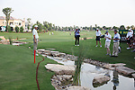 Dubai World Championship Golf. Earth Course,.Jumeirah Golf Estate, Dubai, U.A.E...Padraig Harrington walks round where his ball lies in the water on the 18th during the second round of the Dubai World Golf championship..Photo: Fran Caffrey/www.golffile.ie...