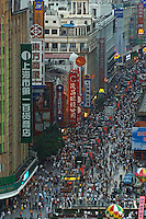 Saturday shoppers pack Shanghai's famous shopping street, Nanjing Lu.  The street attracts hundreds of thousands of consumers and is home to many of the world's largest brand names..