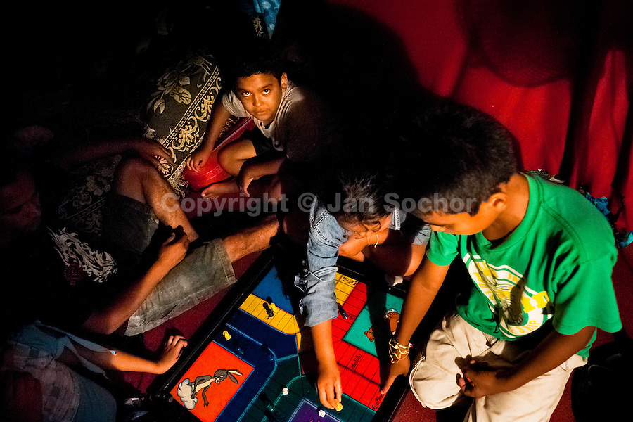 Salvadorean children play a table game in the trailer belonged to the Circo Brasilia, a family run circus travelling in Central America, 10 May 2011. The Circo Brasilia circus belongs to the old-fashioned traveling circuses with a usual mixture of acrobat, clown and comic acts. Due to the general loss of popularity caused by modern forms of entertainment such as movies, TV shows or internet, these small family enterprises balance on the edge of survival. Circuses were pushed away and now they have to set up their shows in more remote villages. The circus art and culture is slowly dying in Latin America.