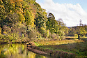 River Lathkill reflecting Autumn colours, Lathkill Dale NNR, Peak District National Park, UK. October.