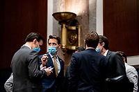 United States Senator Josh Hawley (Republican of Missouri) talks with a fellow US Senators and aides during a Senate Judiciary Committee business meeting to consider authorization for subpoenas relating to the Crossfire Hurricane investigation and other matters on Capitol Hill in Washington, DC on June 11, 2020. <br /> Credit: Erin Schaff / Pool via CNP/AdMedia
