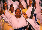 """The Celestial Church of Christ. 1990s London UK. Harvest festival. This west African church was founded by S B J Oshoffa Mainly attended by Yoruba people from western Nigeria the church  flourishes with offshoots in London Paris and New York This  photograph is taken from the book The Storm is Passing Over"""""""