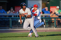 Harrisburg Senators third baseman Drew Ward (17) tags Aderlin Rodriguez (34) in a run down during a game against the Bowie Baysox on May 16, 2017 at FNB Field in Harrisburg, Pennsylvania.  Bowie defeated Harrisburg 6-4.  (Mike Janes/Four Seam Images)