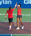 Venus Williams and Leander Paes play at the World Team Tennis match between the Washington Kastles and the Boston Lobsters on July 16, 2012 in Washington, DC.