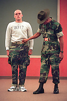 SF.Marines.#8.db.07-11... A drill instructor uses recruit Bill Norris (cq) as a example to other recruits to show how a recruit should wear his Marine issued belt and camoflaged pants. This was about 5am on the second day of his arrival at the Marine Corps Recruit Depot in San Diego. He and other recruits had already been awake and kept up for 25 hours at this point, and did not sleep until 12 hours later that day. Photo by David Bohrer/FTT.