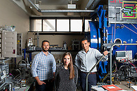 Seen here in the Space Propulsion Laboratory, lab director Dr. Paulo Lozano (right), and Ph.D. candidates Natalya Brikner and Louis Perna (left) have been working on the ion Electrospray Propulsion System (iEPS) for CubeSats at MIT in Cambridge, Massachusetts, USA.  The device is used to maneuver a 10cm cubic satellite in space. Brikner and Perna have formed a company, Accion Systems Incorporated, to commercialize the research. Brikner, graduating in Winter 2014, is CEO of the company, and Perna is co-founder. The research at MIT was done under Space Propulsion Lab director Paulo Lozano, professor in MIT's Department of Aeronautics and Astronautics.