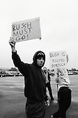 Hershey, Pennsylvania.USA.October 21, 2004..A hand full of anti-Bush demonstrators exchange insults with nearly 25,000 Bush supporters on their way to a Bush rally.