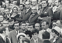 Silent and Grieving; mourners watch Pierre Laporte's funeral cortege leave Notre Dame Church for Cote des Neiges Cemetery; Quebec Premier Robert Bourassa and Prime Minister Pierre Trudeau unnouced in the crowd. Most of the officials at the funeral mass stayed away from the burial rite because police believe the route to the grave would have been too difficult to guard against terrorists.<br /> <br /> 1970<br /> <br /> PHOTO :  Doug Griffin - Toronto Star Archives - AQP