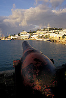 Bermuda, St. George's Parish, Cannon overlooking St. George's Harbor in St George in Bermuda.