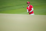 CHON BURI, THAILAND - FEBRUARY 16:  Jenny Shin of USA chips into the 14th green during day one of the LPGA Thailand at Siam Country Club on February 16, 2012 in Chon Buri, Thailand.  Photo by Victor Fraile / The Power of Sport Images