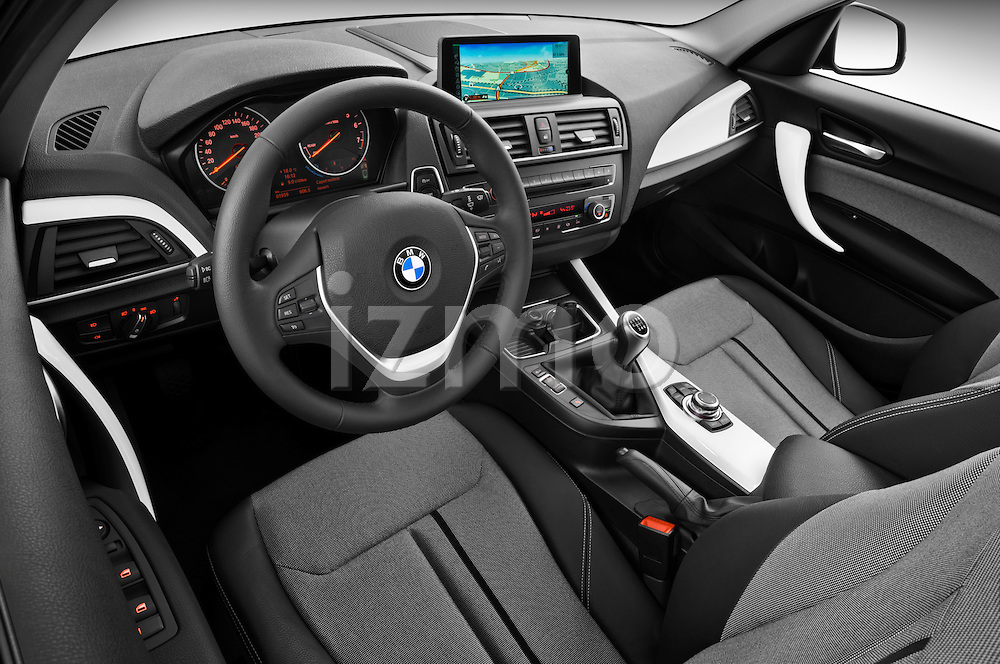 High angle dashboard view of a 2011 - 2014 BMW 118d 5 Door hatchback.