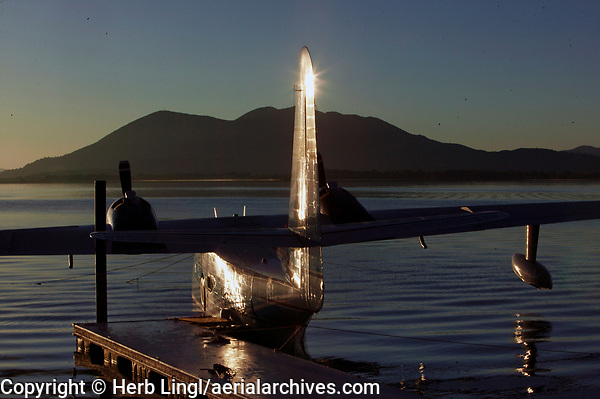 A Grumman HU-16, Albatross, N44RD, docked at the Skylark Shores Resort during the Clear Lake Seaplane Splash-In, Lakeport, Lake County, California with Mount Konocti in the background