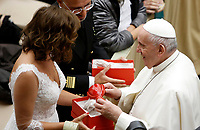 Pope Francis receives a present from a newlywed couple at the end of his weekly general audience in the Paul VI hall at the Vatican, January 22, 2020.<br /> <br /> UPDATE IMAGES PRESS/Riccardo De Luca<br /> <br /> STRICTLY ONLY FOR EDITORIAL USE