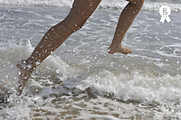 Woman running through the surf (Licence this image exclusively with Getty: http://www.gettyimages.com/detail/89652985 )