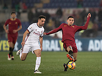Calcio, Serie A: AS Roma - AC Milan, Roma, stadio Olimpico, 25 febbraio, 2018.<br /> Roma's Lorenzo Pellegrini (r) in action with Milan's Giacomo Bonaventura (l) during the Italian Serie A football match between AS Roma and AC Milan at Rome's Olympic stadium, February 28, 2018.<br /> UPDATE IMAGES PRESS/Isabella Bonotto