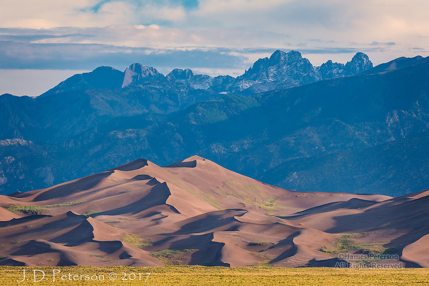 Morning Light, Great Sand Dunes National Monument ©2017 James D Peterson.  After dawn on a summer day, I waited until after the sun belatedly broke through some early morning clouds to capture this image.