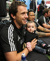 All Black Ben Smith meets with a young supporter courtesy of Adidas prior to the Rugby Championship, Bledisloe Cup test match between New Zealand and Australia, Champions of the World store, Dunedin, New Zealand, Friday, October 18, 2013. Photo: Dianne Manson / photosport.co.nz