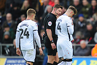 Joe Rodon of Swansea City leaves the pitch for treatment for a cut to the face during the Sky Bet Championship match between Swansea City and West Bromwich Albion at the Liberty Stadium in Swansea, Wales, UK. Saturday 07 March 2020