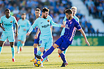 Lionel Andres Messi (l) of FC Barcelona fights for the ball with Ruben Salvador Perez del Marmol of CD Leganes during the La Liga 2017-18 match between CD Leganes vs FC Barcelona at Estadio Municipal Butarque on November 18 2017 in Leganes, Spain. Photo by Diego Gonzalez / Power Sport Images