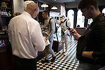 © Joel Goodman - 07973 332324 . 25/07/2015 . Manchester , UK . Caffe Nero . Visitors to Comic Con on the streets of Manchester after venue - Manchester Central's - doors are shut . Photo credit : Joel Goodman