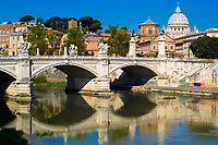 Famous St. Peter's Basilica and St. Angelo Bridge and reflections on the Tiber River, under a blue sky, Vatican City, Rome Italy, Southern Europe