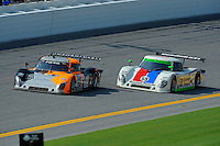 4 July, 2009, Daytona Beach, Florida USA.#60 Michael Shank Racing Ford/Riley of Oswaldo Negri & Mark Patterson (L) and the #59 Brumos Porsche/Riley of J.C. France & Joao Barbosa..©2009 F.Peirce Williams, USA.