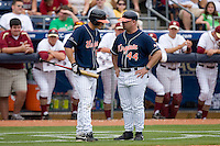 Virginia Cavaliers associate head coach Kevin McMullan #44 gives instructions to John Hicks #8 at Durham Bulls Athletic Park May 24, 2009 in Durham, North Carolina. The Virginia Cavaliers defeated the Florida State Seminoles 6-3 to win the 2009 ACC Baseball Championship.  (Photo by Brian Westerholt / Four Seam Images)