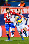 Fernando Torres (c) of Atletico de Madrid fights for the ball with Jonathan Castro Otto Jonny (r) of RC Celta de Vigo during their La Liga match between Atletico de Madrid and RC Celta de Vigo at the Vicente Calderón Stadium on 12 February 2017 in Madrid, Spain. Photo by Diego Gonzalez Souto / Power Sport Images