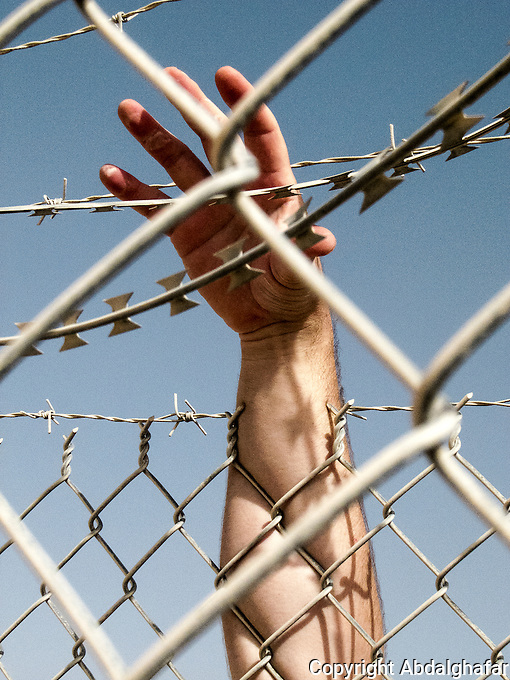 This hand reflects the pain and the prison in which we are living in the camp.