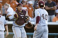 Arizona State Sun Devil catcher Xorge Carrillo #14 celebrates a big out with teammate Mitchell Lambson #40 against the Texas Longhorns in NCAA Tournament Super Regional Game #3 on June 12, 2011 at Disch Falk Field in Austin, Texas. (Photo by Andrew Woolley / Four Seam Images)