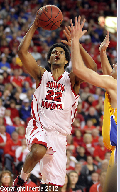 VERMILLION, SD - FEBRUARY 9: Allen Saint-Gelais #22 from the University of South Dakota takes the ball to the basket against South Dakota State in the second half of their game Thursday night at the DaktaDome in Vermillion, SD. (Photo by Dave Eggen/Inertia)