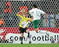 Guillermo Franco (10) of Mexico moves in alone on Angola goalkeeper Joao Ricardo. Mexico and Angola played to a 0-0 tie in their FIFA World Cup Group D match at FIFA World Cup Stadium, Hanover, Germany, June 16, 2006.