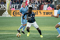 FOXBOROUGH, MA - SEPTEMBER 29: Jalil Anibaba #3 of New England Revolution brings the ball forward as Heber #9 of New York City FC comes in to tackle during a game between New York City FC and New England Revolution at Gillettes Stadium on September 29, 2019 in Foxborough, Massachusetts.