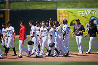 Inland Empire 66ers third baseman Jordan Zimmerman (5) celebrates with Leonardo Rivas (3) after Rivas' walk-off double during a California League game against the Modesto Nuts on April 10, 2019 at San Manuel Stadium in San Bernardino, California. Inland Empire defeated Modesto 5-4 in 13 innings. (Zachary Lucy/Four Seam Images)
