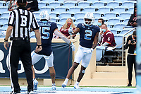 CHAPEL HILL, NC - OCTOBER 10: Dyami Brown #2 of North Carolina celebrates his 43-yard touchdown reception with teammate Beau Corrales #15 during a game between Virginia Tech and North Carolina at Kenan Memorial Stadium on October 10, 2020 in Chapel Hill, North Carolina.