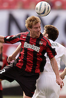 The MetroStars' Chris Leitch goes up for a header with Pat Noonan of the Revolution. The MetroStars and the New England Revolution played to a 2 - 2 tie at Giant's Stadium, East Rutherford, NJ, on Saturday May 21, 2005.