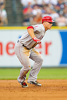 Mike Trout (27) of the Los Angeles Angels takes his lead off of second base against the Detroit Tigers at Comerica Park on June 25, 2013 in Detroit, Michigan.  The Angels defeated the Tigers 14-8.  (Brian Westerholt/Four Seam Images)