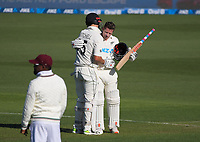 NZ's Daryl Mitchell congratulates Henry Nicholls (right) on his century during day one of the International Test Cricket match between the New Zealand Black Caps and West Indies at the Basin Reserve in Wellington, New Zealand on Friday, 11 December 2020. Photo: Dave Lintott / lintottphoto.co.nz