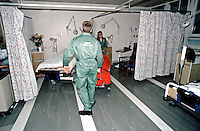 Paramedics pushing a patient on a stretcher into a hospital ward. This image may only be used to portray the subject in a positive manner..©shoutpictures.com..john@shoutpictures.com