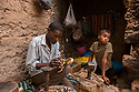 """Morocco - Ouarzazate - Mbarek Arouaie, 53, portrayed next to his son (right) in his workshop of Ait Kdif, in Ouarzazate. Arouaie is a local blacksmith and jeweler whose manufacts, from swords to helmets, turbants and necklaces, have appeared in several movies. Arouaie belongs to a family of four artesans and started producing manufacts and props in 1990 for 1001 Nights, a French-Italian movie starring a debutant Catherine Zeta-Jones. His best working memories are those related to Martin Scorsese's Kundun, a movie about the life of the 14th Dalai Lama which was almost entirely shot in Ouarzazate. """"The production stayed here for almost an year, giving work to the whole city"""" he remembers with fondness. """"Once, they used to command us 3,000 swords for a single movie. Now, they just order two or three and replicate the others digitally."""""""