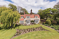 BNPS.co.uk (01202) 558833. <br /> Pic: SandersonYoung/BNPS<br /> <br /> The house and large garden.<br /> <br /> A quirky 'show home' for a brickwork owner where Lewis Carroll is believed to have stayed while writing some of his Alice in Wonderland books is on the market for just under £1m.<br /> <br /> Red Cottage is a striking Grade II listed property in Whitburn, Tyne and Wear, where Charles Dodgson, otherwise known as Lewis Carroll, regularly visited family.<br /> <br /> The unusual 179-year-old home was built to show off as many design features as possible, and has a walled garden and even an air raid shelter.