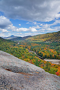 Autumn foliage from Attitash Crag in Bartlett, New Hampshire USA during the autumn months. The Saco River is in view.