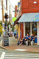 Photography of an art gallery crawl event in Charlotte's NoDa Historic Art District community. Considered by many to be Soho's little sister, NoDa (North Davidson) is home to a collection of galleries, performance venues, funky restaurants and retailers. Photo is part of a series of images taken during a July 2012 gallery crawl.