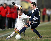 Casey Townsend #11of the University of Marylandcuts past Chase Tennant #7 of the University of Michigan during an NCAA quarter-final match at Ludwig Field, University of Maryland, College Park, Maryland on December 4 2010.Michigan won 3-2 AET.
