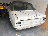 BNPS.co.uk (01202) 558833.<br /> Pic: Charterhouse/BNPS<br /> <br /> Pictured: A clapped-out Ford Escort which for £27,000.<br /> <br /> A humble Ford Escort car has sold for a whopping £50,000 as the market for 'modern classic' motors continues to soar.<br /> <br /> The 1980 Escort RS2000 has doubled in value since it was bought by canny Will Davies for £26,000 in 2016.<br /> <br /> Meanwhile, a clapped-out 1975 Escort RS2000 that had languished in a garage for nearly 25 years has also sold for £27,000.