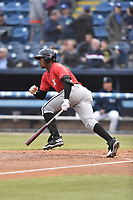 Kannapolis Intimidators right fielder Micker Adolfo (27) swings at a pitch during a game against the Asheville Tourists at McCormick Field on April 18, 2017 in Asheville, North Carolina. The Intimidators defeated the Tourists 6-1. (Tony Farlow/Four Seam Images)