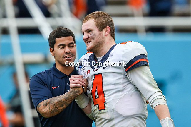 Illinois Fighting Illini quarterback Reilly O'Toole (4) leaves the field after the Heart of Dallas Bowl Bowl game between the Illinois Fighting Illini and the Louisiana Tech Bulldogs at the Cotton Bowl Stadium in Dallas, Texas. Louisiana defeats Illinois 35 to 18.